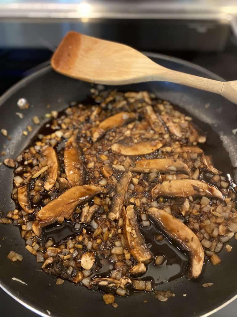 Mushrooms and marinade added to pan