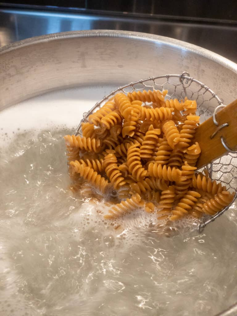 whole grain rotini pasta boiling in a pot