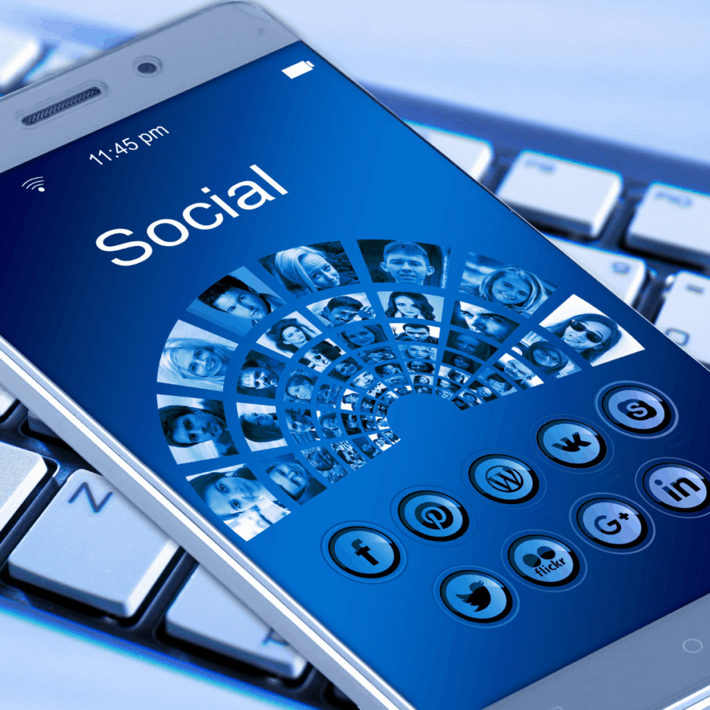 mobile phone with the word social and groups of people