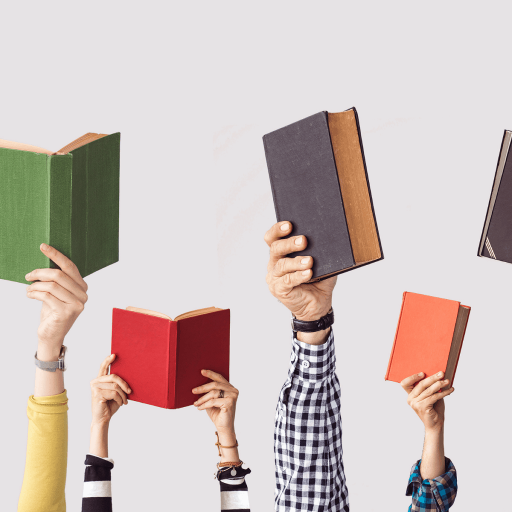 many arms holding up colorful books