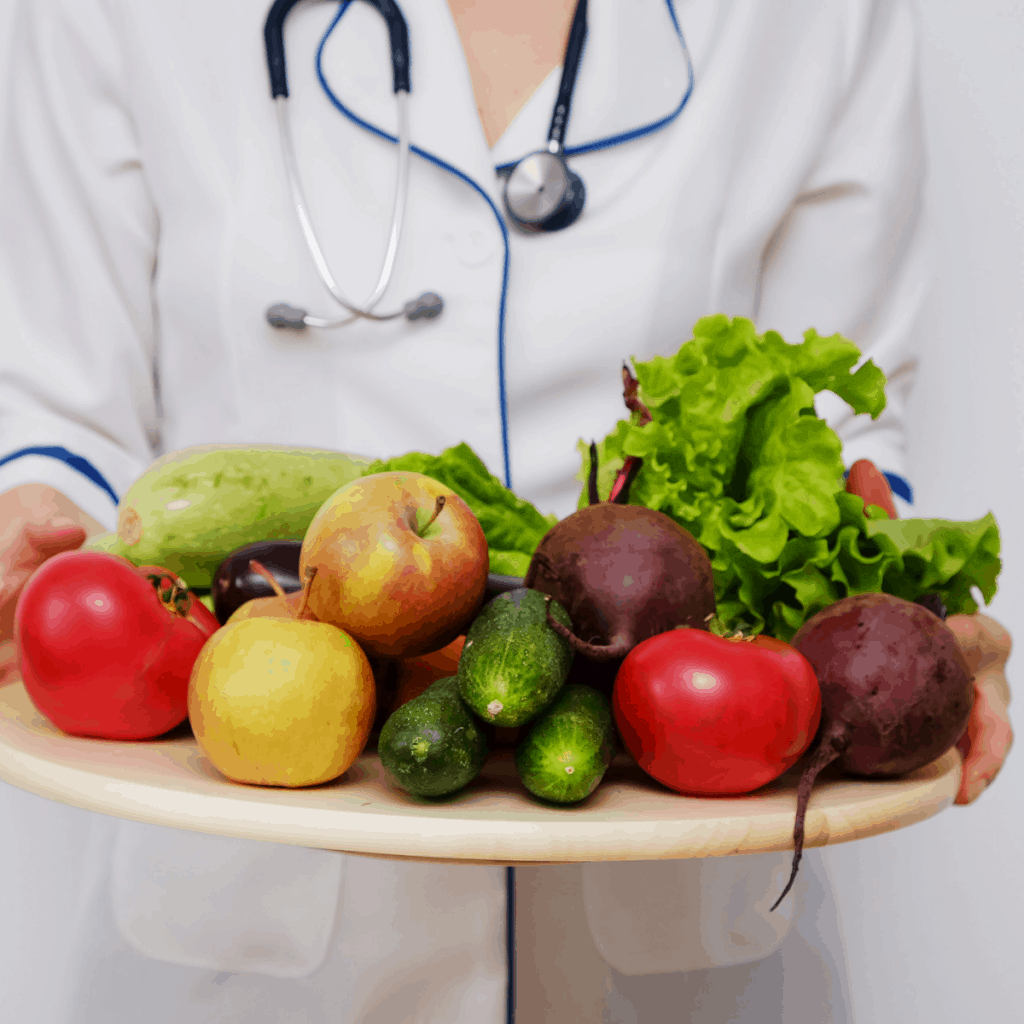 medical professional with stethoscope holding fruits and vegetables