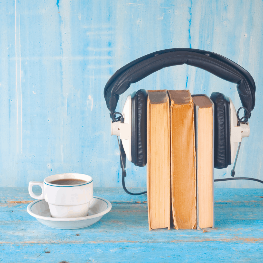 books wearing headphones and a cup of coffee