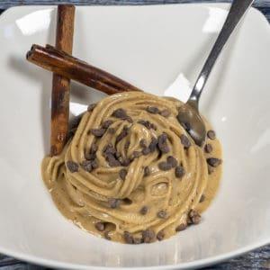 Cinnamon Bun Nice Cream in Bowl witih cinnamon stick and spoon