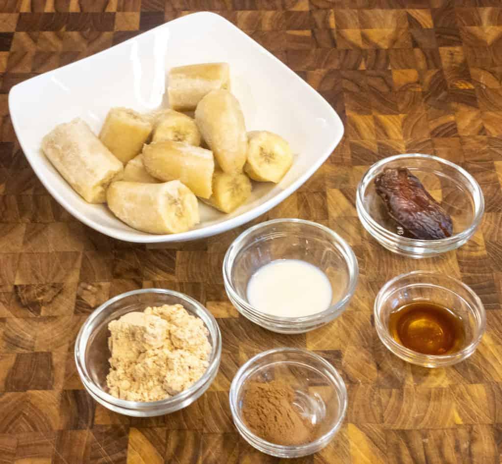 Cinnamon Bun Nice Cream ingredients all measured out in bowls