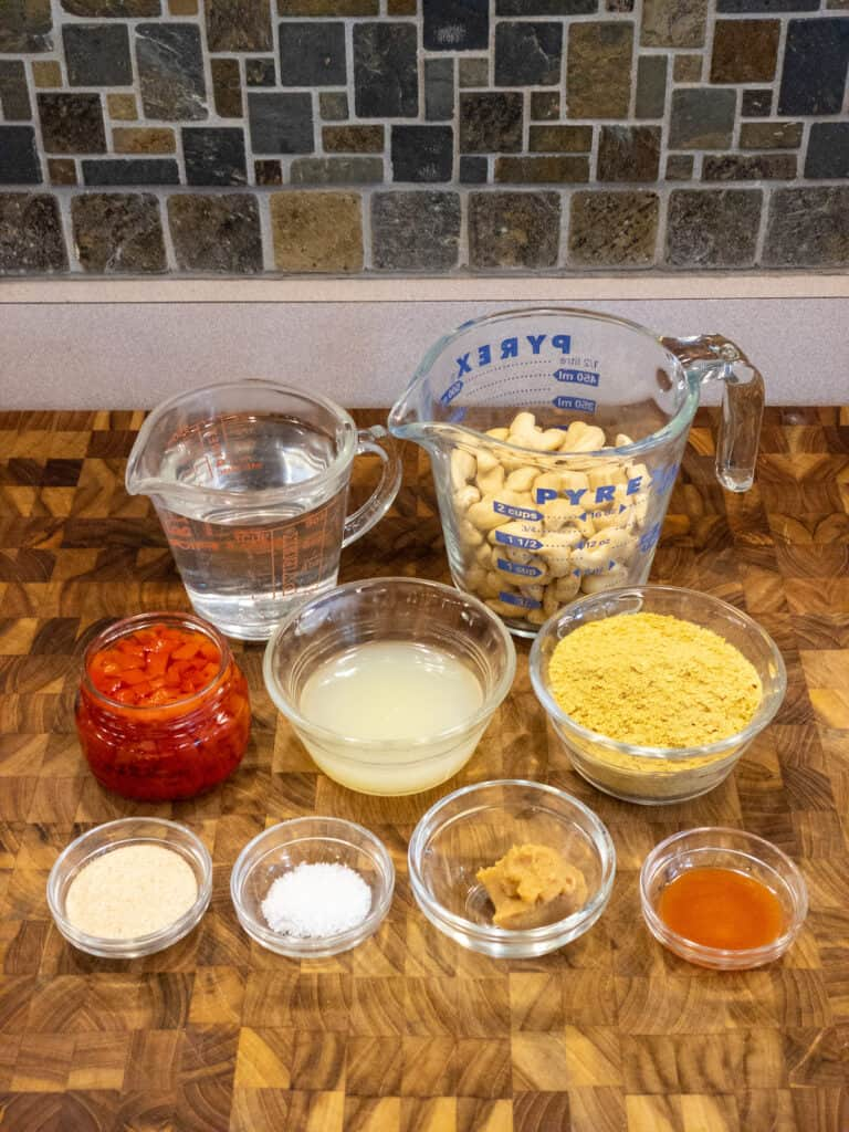 ingredients for dairy-free cheese sauce on cutting board