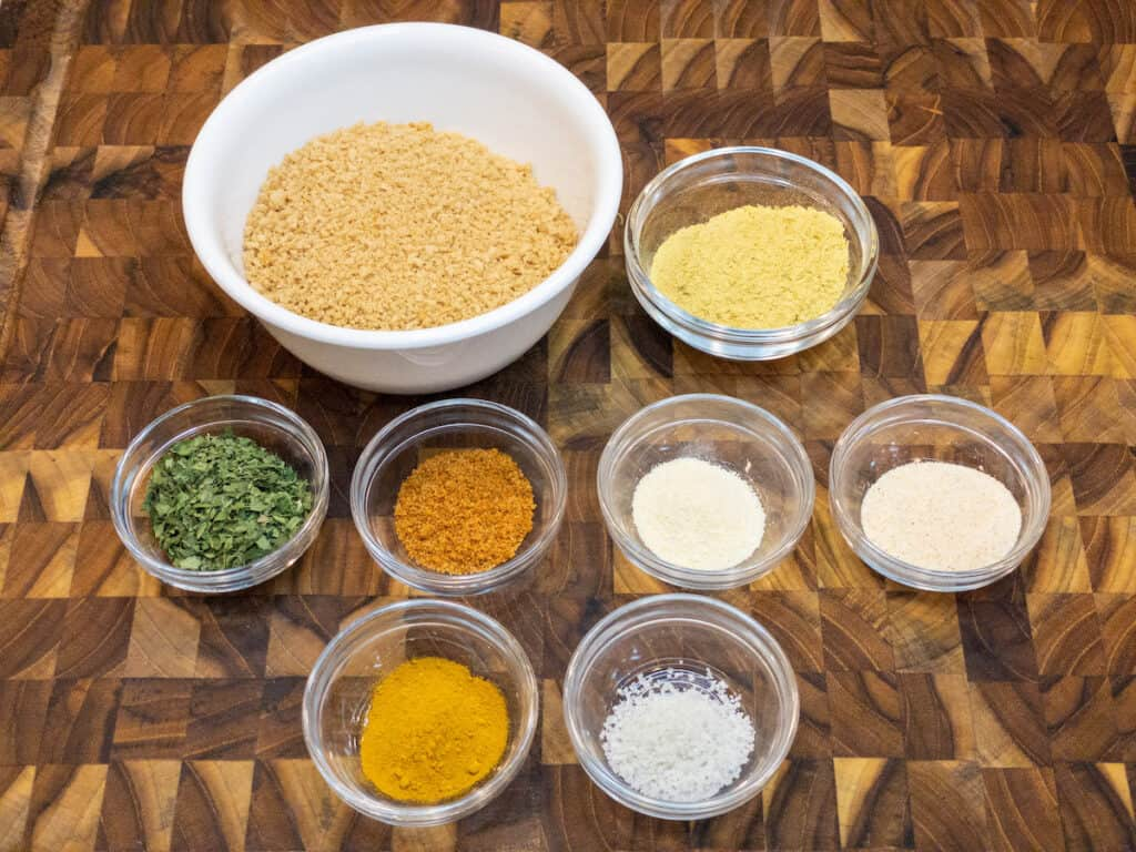 wfpb crab cake breading ingredients in bowls on wooden cutting board