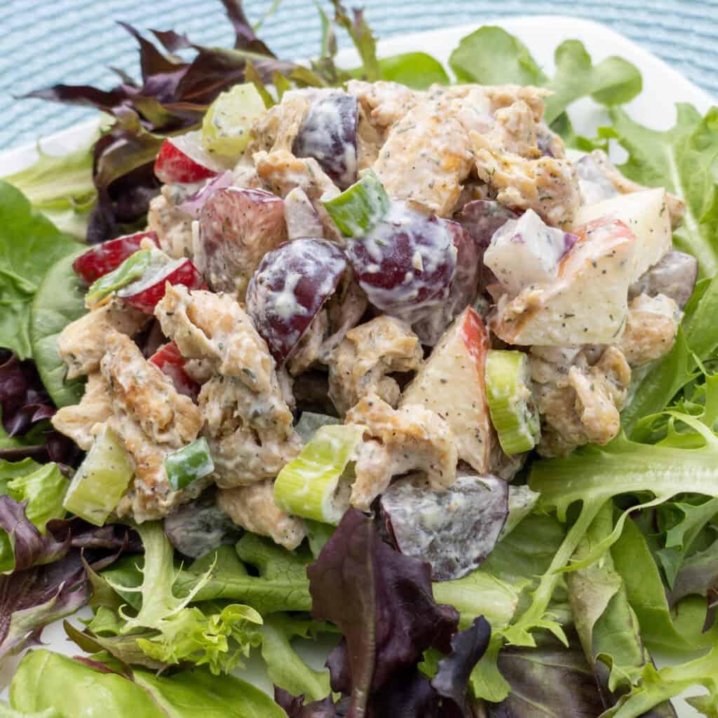 WFPB Soy Curl Waldorf Salad closeup over greens