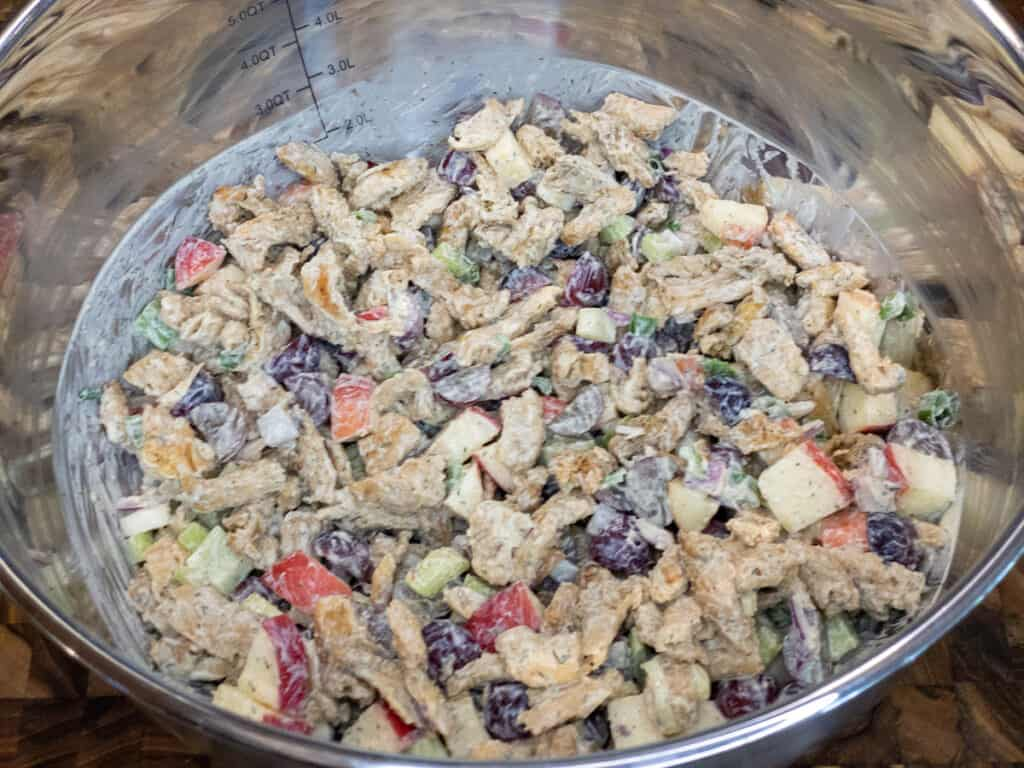 WFPB Soy Curl Waldorf Salad Ingredients stirred together in large Stainless steel bowl