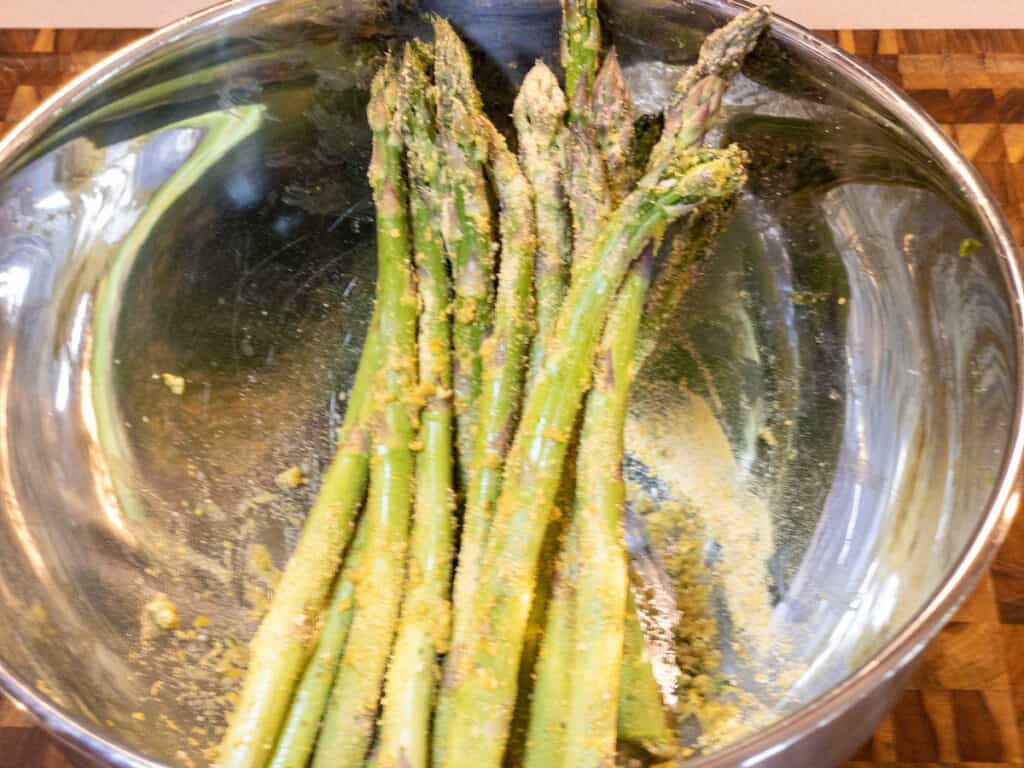 WFPB oil-free air-fried asparagus in bowl coated with aquafaba and dry spices