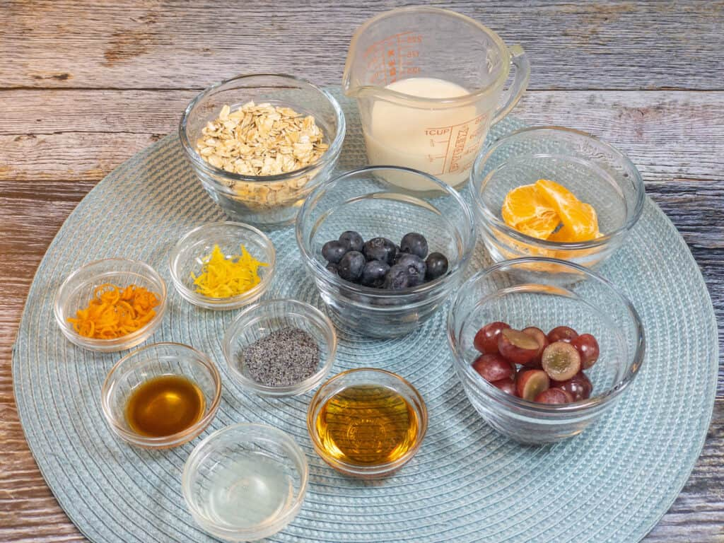 glass bowls filled with overnight oats ingredients