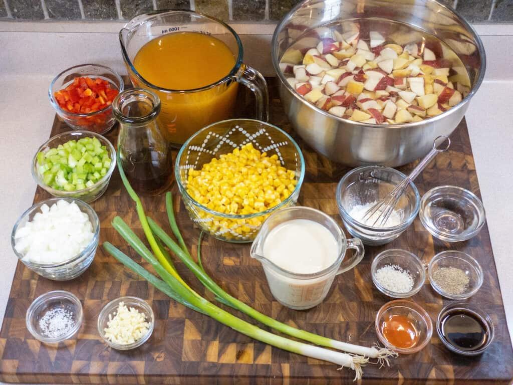 Sweet Corn Chowder Ingredients on wooden cutting board